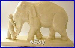 Groupe art-déco en faïence craquelée représentant un éléphant et son cornac