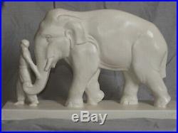 RARE ÉLÉPHANT ET CORNAC. Céramique craquelée blanche années 30. ART DECO